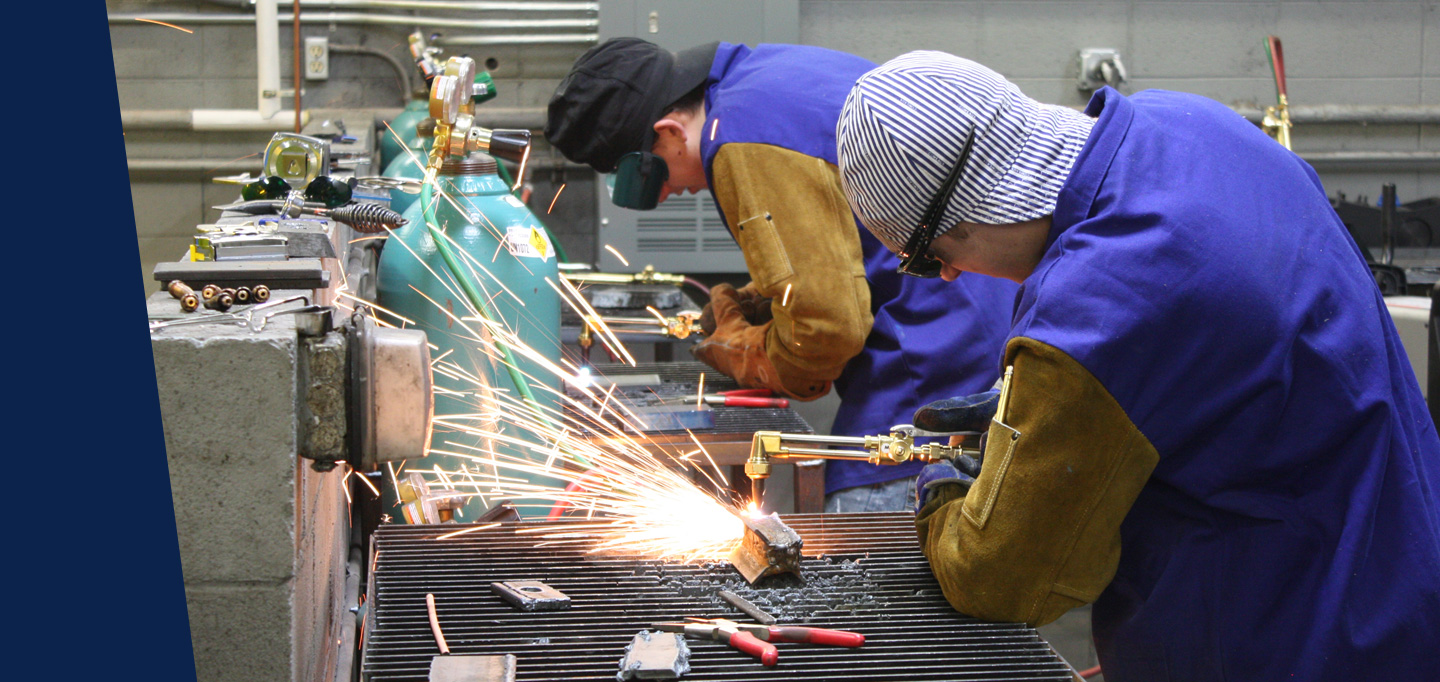 Students working with welding equipment.