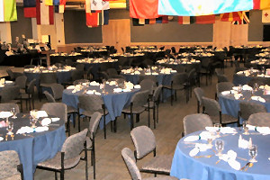 a room full of decorated banquet tables