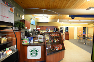 a close up of a checkout area with a Starbucks logo
