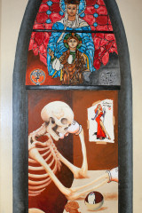 a stained glass window with a skeleton